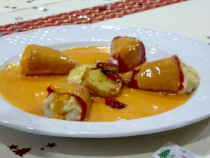 Red peppers stuffed with fish in white sauce